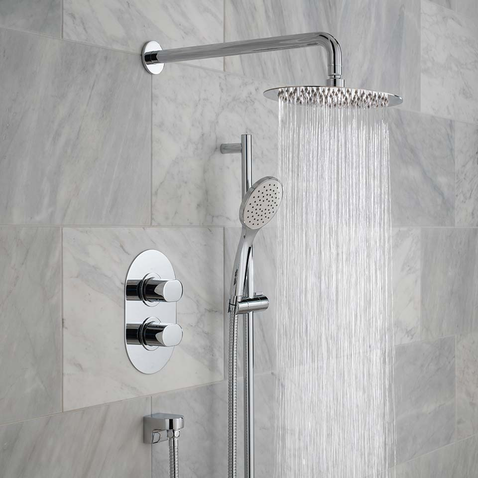 large shower head with marble tiles