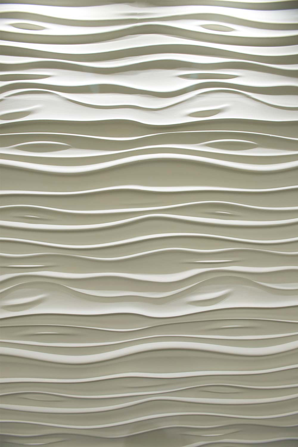On location, a funky wave-pattern tile wall lit from above