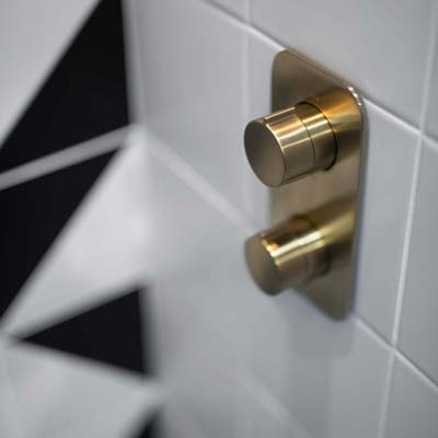 wall mooted thermostatic valve in brushed gold